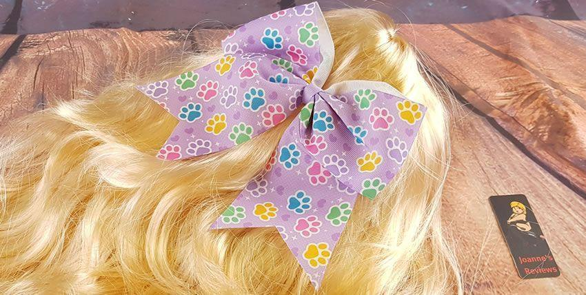 Image showing the paw print bow from Onesies Downunder