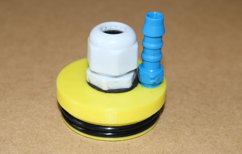 Image showing the cable gland and hose fitting fitted to the cap