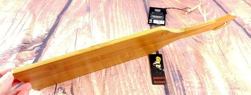 Image showing the thickness of the bamboo spanking paddle