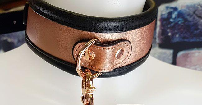 This leash attaches to a D-ring secured by leather and rivets