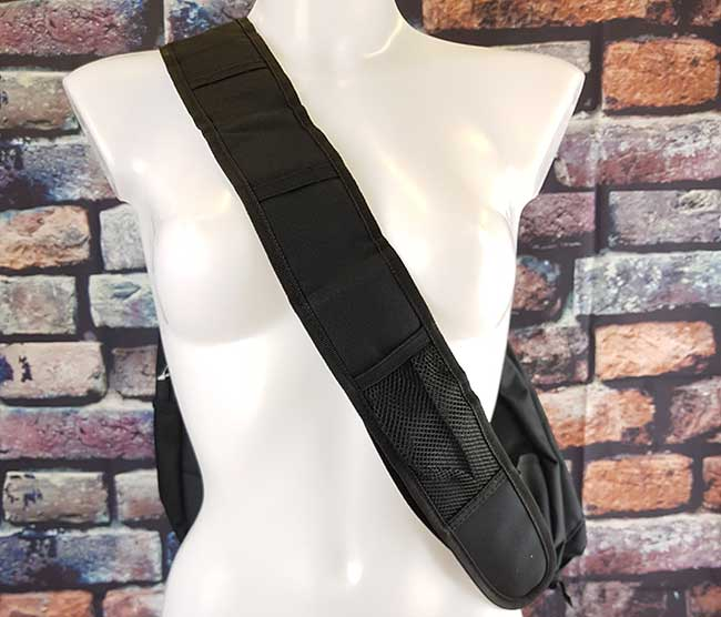 Image showing the shoulder bags chest strap and the mesh pocket