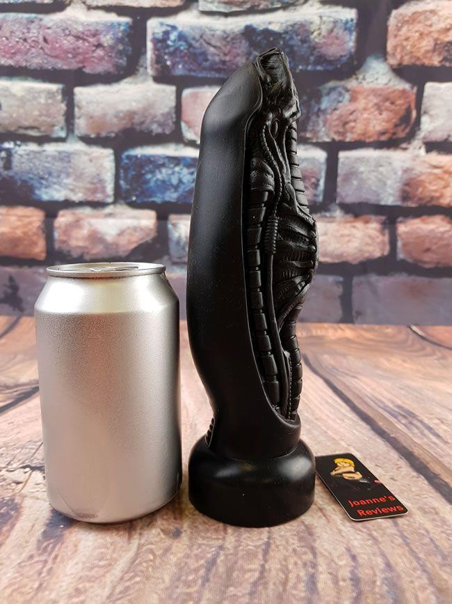Image showing the dildo next to a pop can for scale