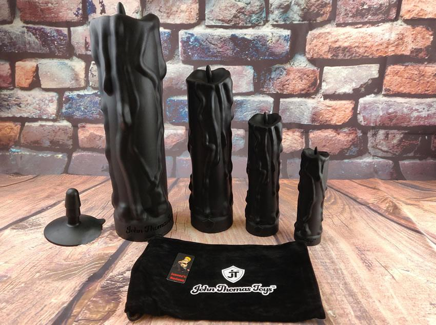 Image showing all four sizes of the Cleopatra's dildos from John Thomas Toys together with the Vac-u-lock suction cup adaptor and the small storage bag