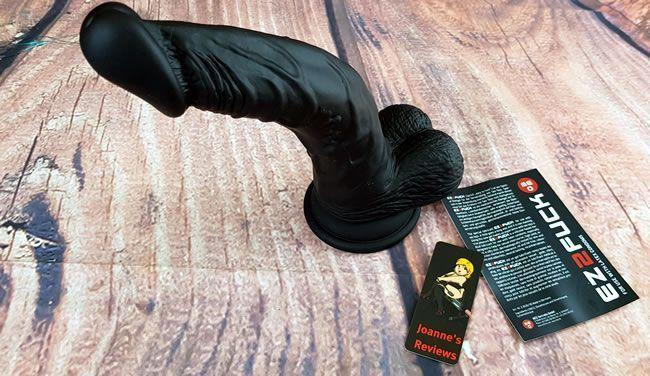 Image showing the Taylor Silicone Dildo and a flyer