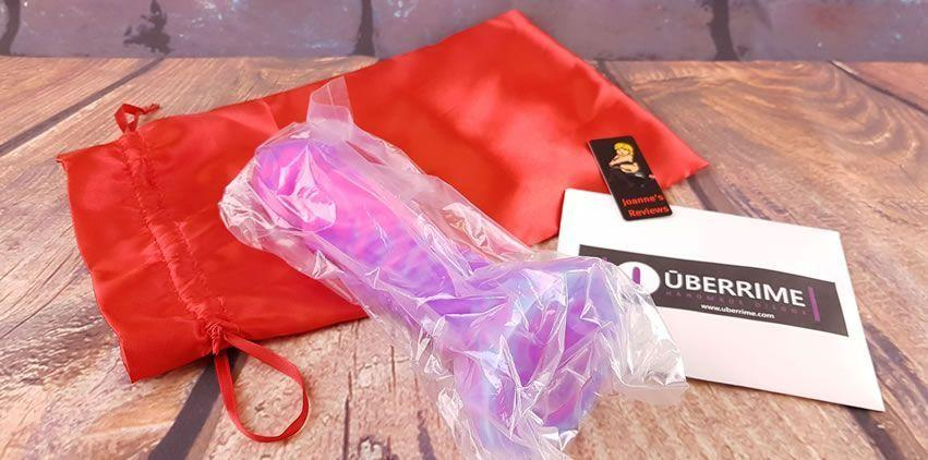 Image showing the Uberrime Helios Sun God Dildo in its sealed pouch and the storage bag
